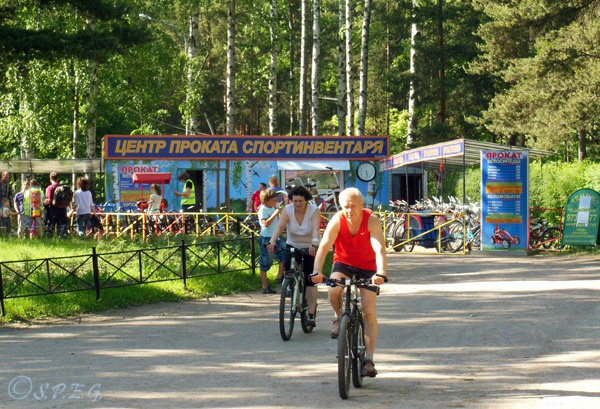 A senior couple going on a private bike tour in the large Sosnovka Park, St Petersburg, Russia.