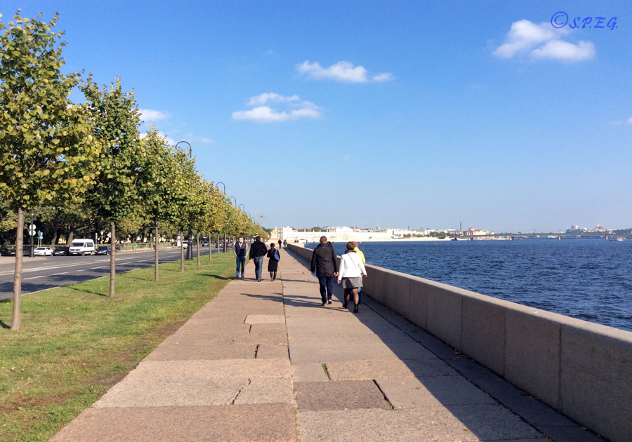Russian people walking along the Neva River during summer, St Petersburg, Russia.