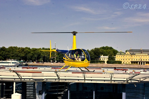 Our partner's helicopter landing in the central part of St Petersburg on the Neva River.