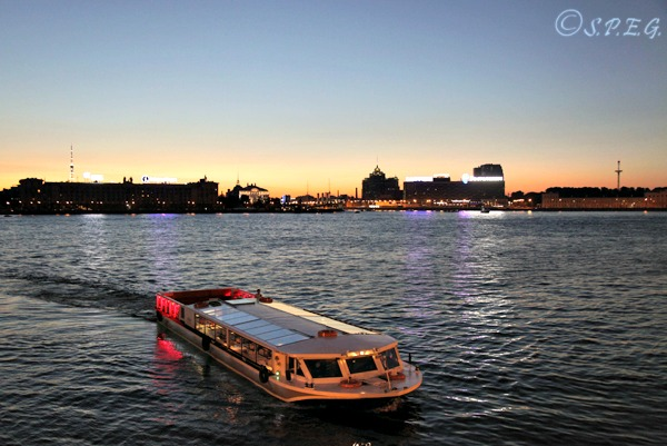 One of our boat tours cruising along the Neva River in the evening, St Petersburg, Russia.