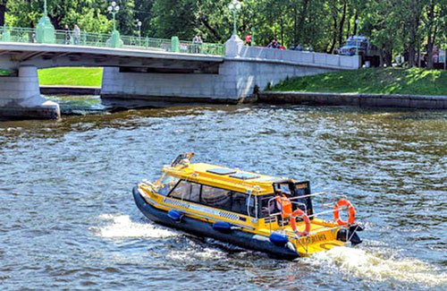 Aquabus running on the Neva River in St Petersburg, Russia - Source Wikimedia.