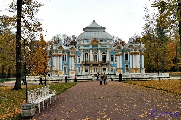 People walking into Catherine Park in Tsarskoye Selo during Autumn.