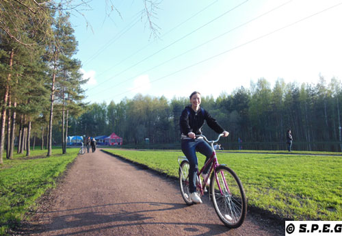 Photo of Me (David) , Anastasia and other people biking on the streets of St Petersburg, Russia.