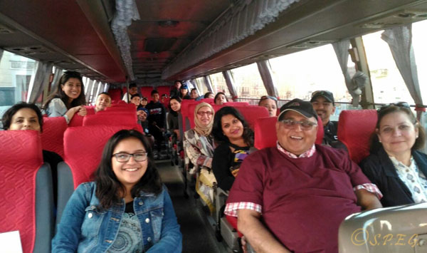 A photo group with visitors from Canada taken on a bus while touring the city with us on July 2016.