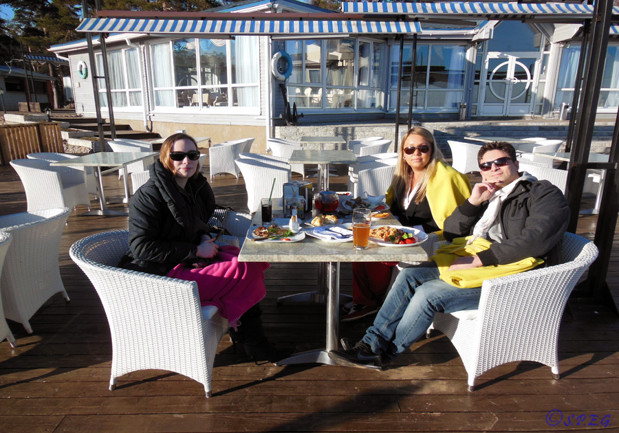At lunch with friends on a beautiful sunny day near the Gulf of Finland, St Petersburg, Russia.