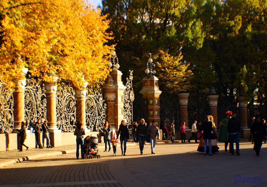 People walking around the Cathedral of the Resurrection, St Petersburg, Russia.