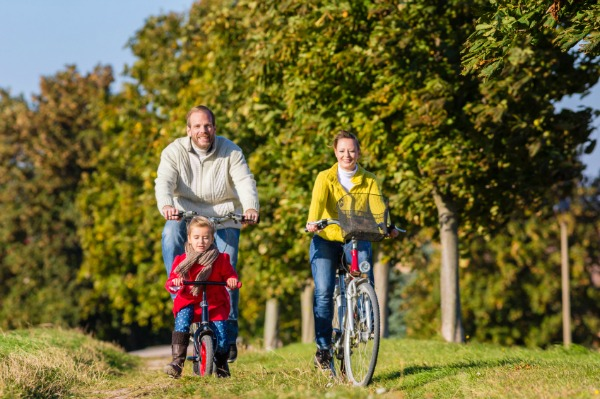 A family enjoing a bike tour in St Petersburg, Russia.