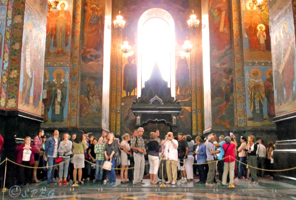 A large group of tourists pictured inside the Church on the Blood in St Petersburg, Russia.