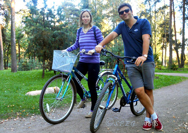 That's us! Me (Davide) and Anastasia posing for a photo with our bikes in Sosnovka Park in St Petersburg, Russia.