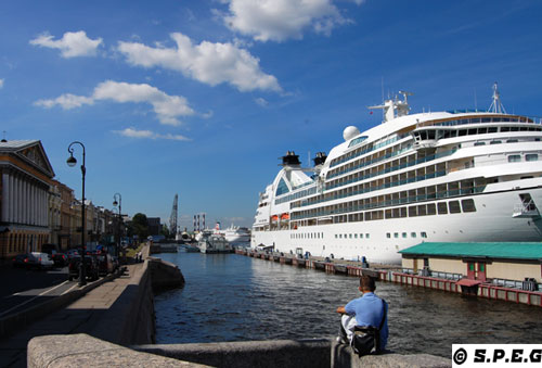 Photo of two major cruise ships and St. Peter Line Ferry docked in St Petersburg Russia.
