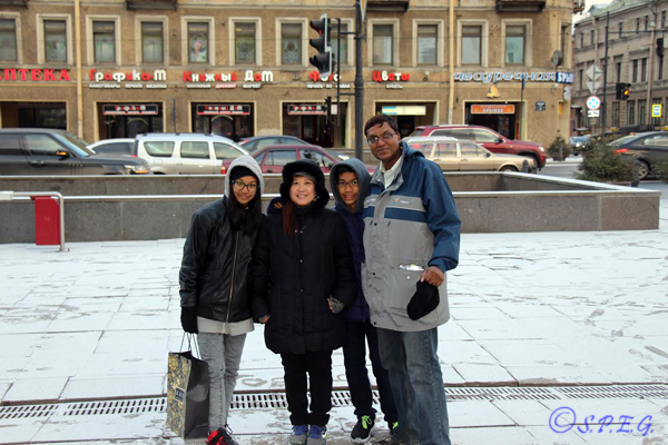 Joseph and his lovely family from Singapore posing for a photo in St Petersburg Russia during Winter 2015.