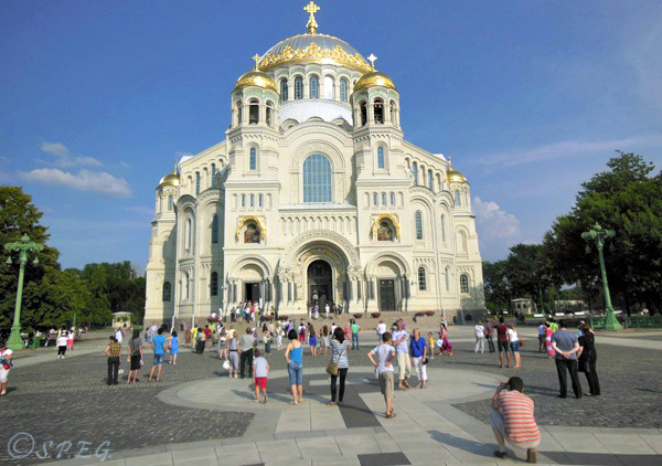 A group of tourists taking photos at the St Nicholas Naval Cathedral in Kronstadt, near St Petersburg, Russia.