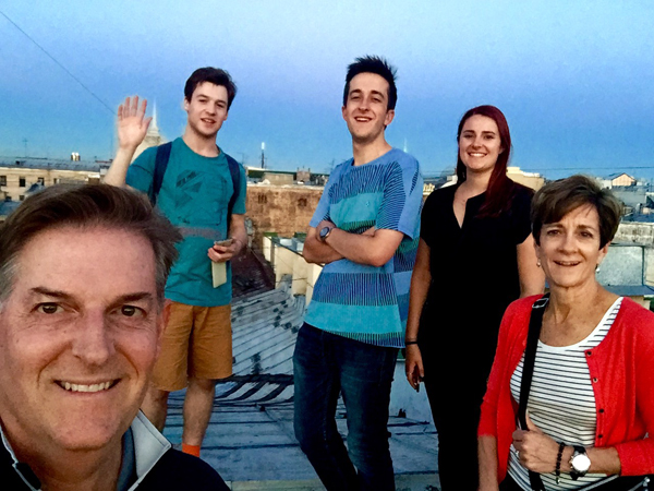 Larry and his family from USA posing for a picture with our guide Alexey on a rooftop tour, July 2016.