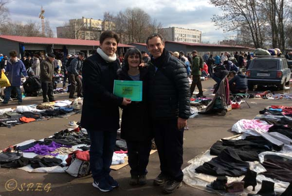 Peter and his wife from UK at Udelnaya Flea Market in St Petersburg Russia in April 2016, posing for a photo with Me (Davide) at the end of the tour.